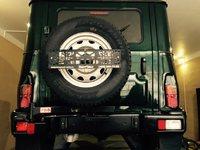 Калитка РИФ в штатный задний бампер УАЗ Хантер с подсветкой номера